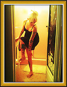 Tattooed blonde girl in bathroom adjusting her dress cellphone photography,Iphone pictures,smartphone pictures
