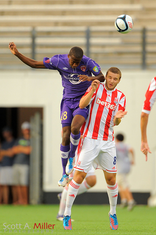 Orlando City Lions midfielder Kevin Molino (18) goes over top of Stoke City Potters midfielder Jamie Ness (8) as they go for a ball during the Potters 1-0 win at the Florida Citrus Bowl on July 28, 2012 in Orlando, Florida. ..©2012 Scott A. Miller.