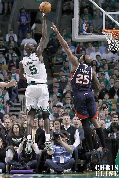 10 May 2012: Boston Celtics power forward Kevin Garnett (5) goes for the skyhook over Atlanta Hawks center Erick Dampier (25) during the Boston Celtics 83-80 victory over the Atlanta Hawks, in Game 6 of the Eastern Conference first-round playoff series, at the TD Banknorth Garden, Boston, Massachusetts, USA.