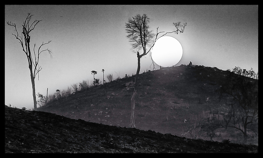 The sun sets on a heavily deforested section of land near the Thai-Cambodian border.