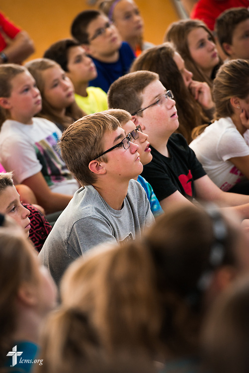 Students listen as the Rev. Dr. James Lamb (not pictured), retiring executive director of Lutherans for Life, leads an Owen's Mission presentation at Trinity Lutheran School on Monday, August 31, 2015, in Bloomington, Ill. LCMS Communications/Erik M. Lunsford