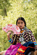 Crow Fair, Parade, Crow Indian Reservation, Montana, girl with fan