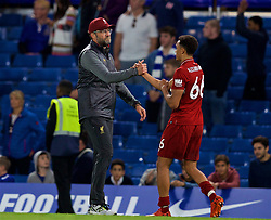 LONDON, ENGLAND - Saturday, September 29, 2018: Liverpool's Trent Alexander-Arnold embraces manager Jürgen Klopp after the FA Premier League match between Chelsea FC and Liverpool FC at Stamford Bridge. (Pic by David Rawcliffe/Propaganda)