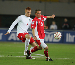 VIENNA, AUSTRIA - WEDNESDAY MARCH 30th 2005: Wales' James Collins and Austria's Christian Mayrleb during the World Cup Qualifying Group Six match at the Ernst Happel Stadium. (Pic by David Rawcliffe/Propaganda)