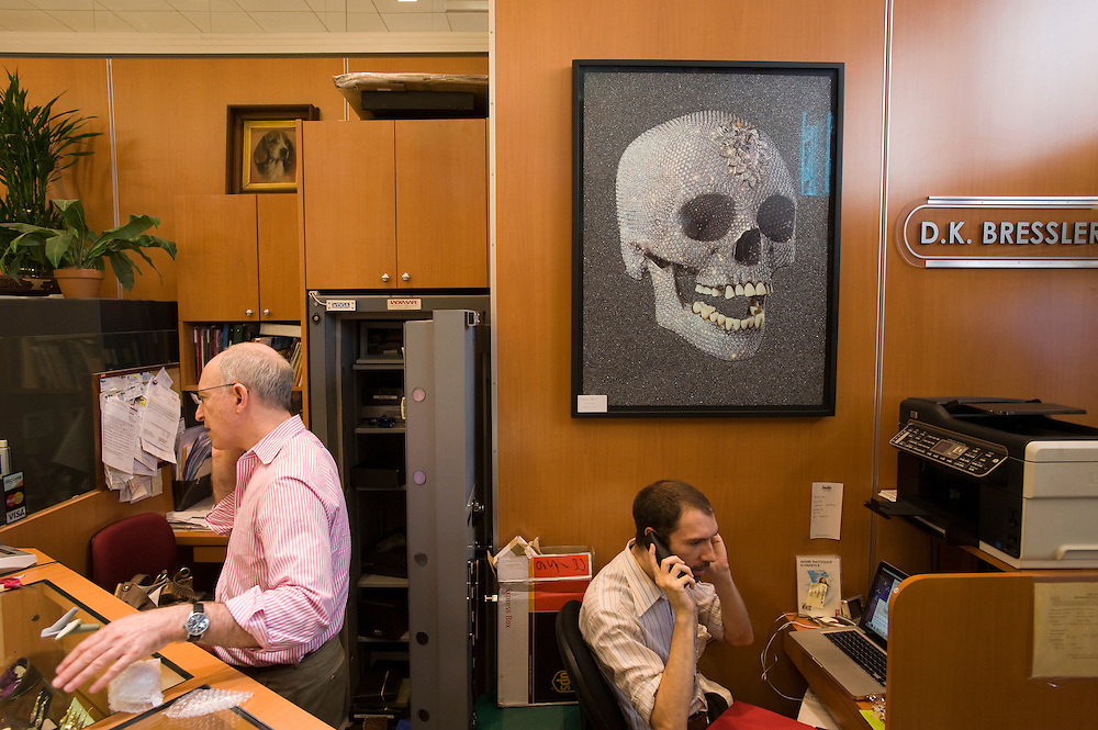 A poster of Damien Hirst's diamond encrusted skull at a jewelry store at Fifth Avenue Jewelry Exchange..Diamond District New York on 47th street between 5th and 6th avenues in midtown Manhattan . The Diamond District is the world's largest shopping district for all sizes and shapes of diamonds and fine jewelry. Many suppliers and jewelry makers also have their stores and workshops right on 47th street.