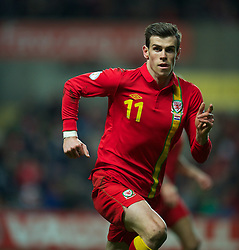 SWANSEA, WALES - Tuesday, March 26, 2013: Wales' Gareth Bale in action against Croatia during the 2014 FIFA World Cup Brazil Qualifying Group A match at the Liberty Stadium. (Pic by David Rawcliffe/Propaganda)