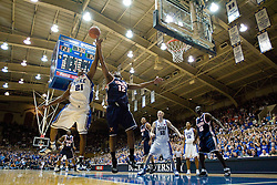 Virginia forward Jamil Tucker (12) and Duke guard DeMarcus Nelson (21) battle for a rebound.  The Duke Blue Devils defeated the Virginia Cavaliers 87-65 in men's basketball at Cameron Indoor Stadium on the campus of Duke University in Durham, NC on January 13, 2008.