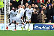 Swansea City midfielder Jefferson Montero celebrates with team mates after scoring the opening goal during the The FA Cup third round match between Oxford United and Swansea City at the Kassam Stadium, Oxford, England on 10 January 2016. Photo by Jemma Phillips.