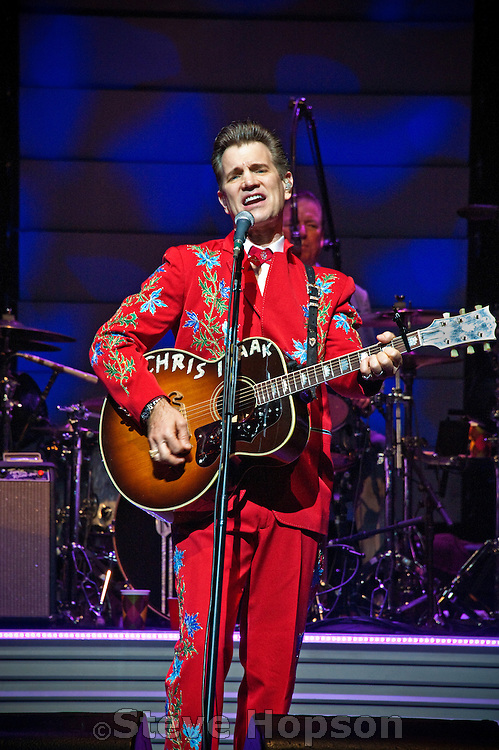 """Chris Isaak performing at ACL Live at the Moody Theater, Austin, Texas, August 26, 2012.  Christopher Joseph """"Chris"""" Isaak (born June 26, 1956) is an American rock musician and actor."""