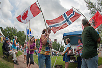 Canada, Norway and Albania were among the many countries represented by local residents as the Parade of International Flags marched through downtown Laconia during the Multicultural Day festivities on Saturday.  (Karen Bobotas/for the Laconia Daily Sun)