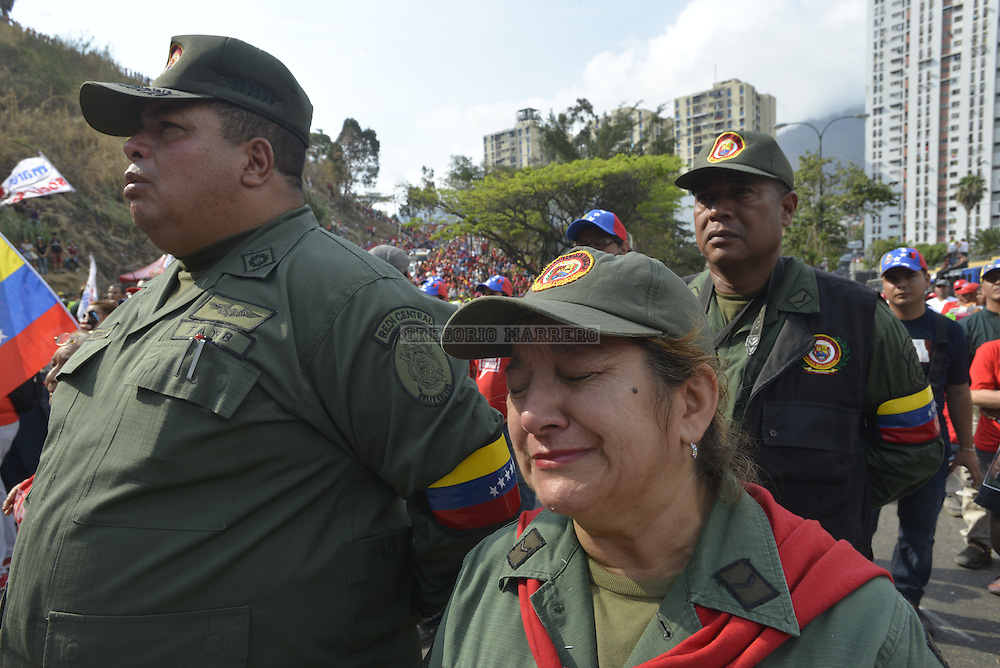 "CARACAS - MARCH 15, 2012: An army sergeant cries during the funeral caravan that moves the mortal remains of President Hugo Chavez to Military Historical Museum, today called Cuartel de la Montaña, in the working-class neighborhood ""23 de Enero"".  Thousands of people followed the funeral procession on the streets of the city. Venezuelan President Hugo Chavez died past March 5 after fight against cancer lasted two years. (Photo by Gregorio Marrero)"