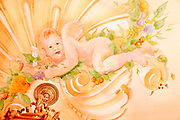 One of the cherubs decorating the splendidly painted ceiling of the dining room in the former Versace mansion, now the Villa Casa Casuarina hotel, on Miami's Beach's Ocean Drive