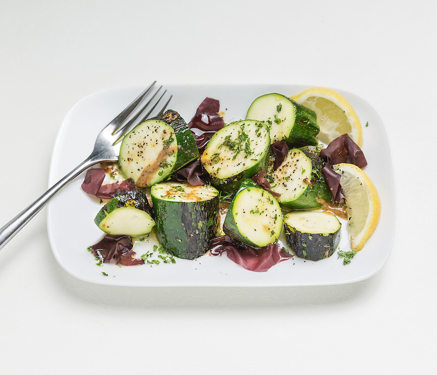 Grilled zucchini with oil, lemon and seaweed.