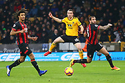 Wolverhampton Wanderers forward Diogo Jota (18) shoots at goal but his shot assists Wolverhampton Wanderers forward Raul Jimenez (9) for his goal during the Premier League match between Wolverhampton Wanderers and Bournemouth at Molineux, Wolverhampton, England on 15 December 2018.