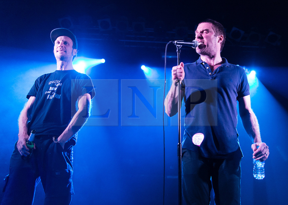 © Licensed to London News Pictures. 30/01/2015. London, UK.   Sleaford Mods performing live at Electric Ballroom.  In this picture - Jason Williamson (right), Andrew Robert Lindsay Fearn (right). Sleaford Mods are an English minimalist post-punk/hip hop duo composed of vocalist Jason Williamson and musician Andrew Robert Lindsay Fearn.  The bands latest album has received critical acclaim throughout the music and national press.  Sleaford Mods songs have been described as embittered rants about such topics as unemployment, criticism of modern working life, criticism of celebrities and pop culture, capitalism and society in general.   Photo credit : Richard Isaac/LNP