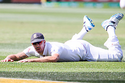 © Licensed to London News Pictures. 27/12/2013. Kevin Pietersen on the ground after diving during Day 2 of the Ashes Boxing Day Test Match between Australia Vs England at the MCG on 27 December, 2013 in Melbourne, Australia. Photo credit : Asanka Brendon Ratnayake/LNP