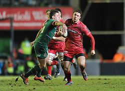 Scarlets replacement, Steven Shingler is tackled by Leicester Tigers fly half, Freddie Burns - Photo mandatory by-line: Dougie Allward/JMP - Mobile: 07966 386802 - 16/01/2015 - SPORT - Rugby - Leicester - Welford Road - Leicester Tigers v Scarlets - European Rugby Champions Cup