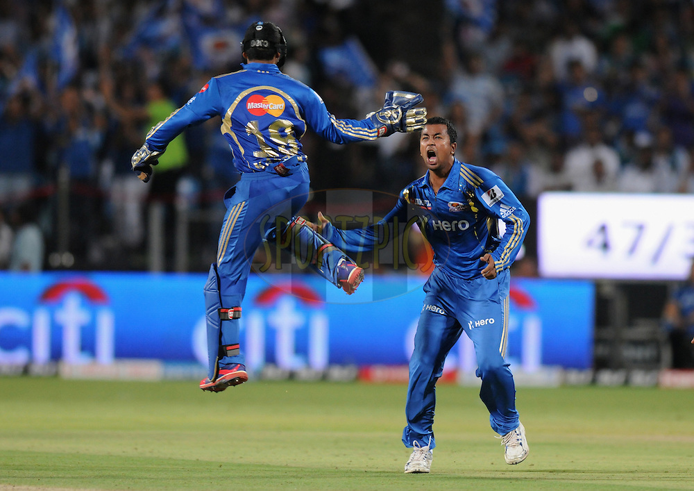 Pragyan Ojha of Mumbai Indians celebrate the wicket of Steve Smith of Pune Warriors India during match 45 of the Indian Premier League ( IPL) 2012  between The Pune Warriors India and the Mumbai Indians held at the Subrata Roy Sahara Stadium, Pune on the 3rd May 2012..Photo by Pal Pillai/IPL/SPORTZPICS