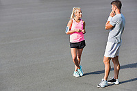 Young couple standing while talking after exercising