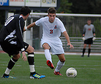 Ohio State midfielder Brady Wahl (3) dribbles forward against Binghamton midfielder Adam Whitehead (10) as OSU takes on Binghamton in the first half of an NCAA men's college soccer game in Columbus, Ohio on Sunday, Sept. 11, 2011, at Jesse Owens Memorial Stadium.