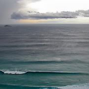 Storm moving in from the south over large surf and two lone surfers, Southwest Coast, Australia. Photo by Jen Klewitz