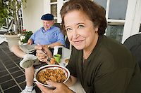 Senior Couple Breakfasting on Porch