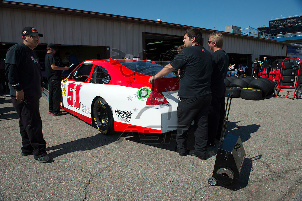Brooklyn, MI - JUN 15, 2012: The race car of Kurt Busch in the garage area during practice for the Quicken Loans 400 race at the Michigan International Speedway in Brooklyn, MI.