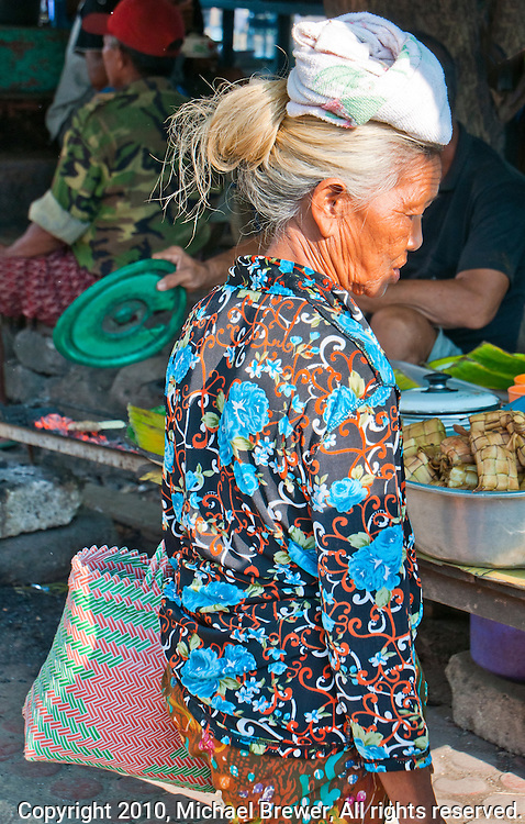 Old Balinese woman shopping at the market on Nusa Penida, Bali, Indonesia