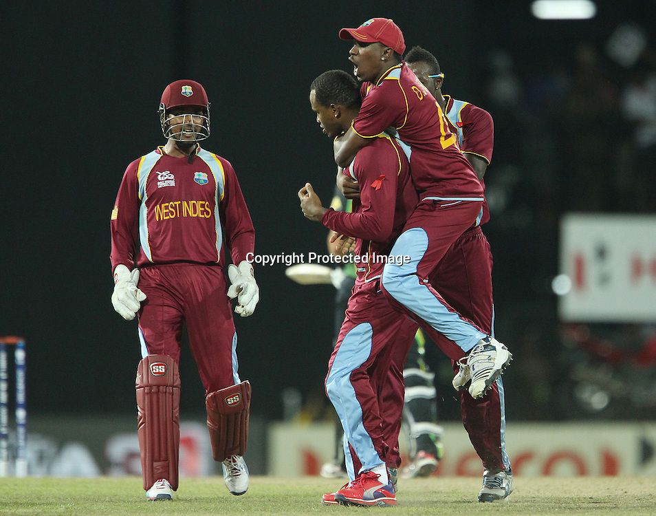Dwayne Bravo of The West Indies and Marlon Samuels of The West Indies celebrates the wicket of Michael Hussey during the ICC World Twenty20 semi final match between Australia and The West Indies held at the Premadasa Stadium in Colombo, Sri Lanka on the 5th October 2012<br /> <br /> Photo by Ron Gaunt/SPORTZPICS