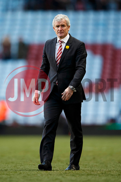 Stoke Manager Mark Hughes (WAL) looks on after his sides 1-4 victory - Photo mandatory by-line: Rogan Thomson/JMP - 07966 386802 - 23/03/2014 - SPORT - FOOTBALL - Villa Park, Birmingham - Aston Villa v Stoke City - Barclays Premier League.