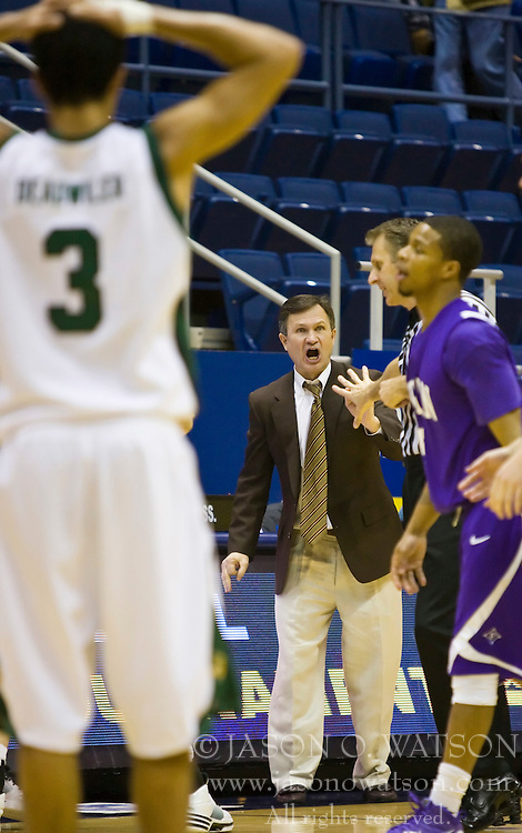 December 29, 2009; Berkeley, CA, USA;  Utah Valley Wolverines guard Shawn Deadwiler (3) watches as head coach Dick Hunsaker is given a technical fould during the second half against the Furman Paladins at the Haas Pavilion.  Furman defeated Utah Valley 77-69.