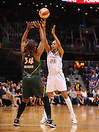 Aug 20, 2010; Phoenix, AZ, USA; Phoenix Mercury forward Tangela Smith makes a pass over Seattle Storm forward Le'coe Willingham during the first half in at US Airways Center.  Mandatory Credit: Jennifer Stewart-US PRESSWIRE