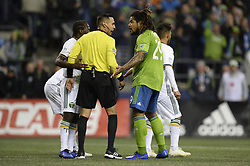 November 8, 2018 - Seattle, Washington, U.S - Seattle's ROMAN TORRES (19) pleads his case to Referee JAIR MARRUFO as the Portland Timbers visit the Seattle Sounders in a MLS Western Conference semi-final match at Century Link Field in Seattle, WA. (Credit Image: © Jeff Halstead/ZUMA Wire)