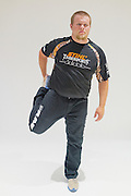 Joshua Wilson stretches before competing at the Stihl Timbersports U.S. Championships at The Norfolk Scope in Norfolk, Virginia on June 20, 2014.