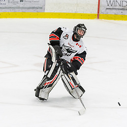 GEORGETOWN, ON - FEBRUARY 2: Goaltender Carson Poulin #1 of the Georgetown Raiders plays the puck on February 2, 2019 at Gordon Alcott Memorial Arena in Georgetown, Ontario, Canada.<br /> (Photo by Michelle Malvaso / OJHL Images)