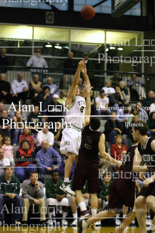 16 December 2006: Andrew Freeman elevates for a shot over the top of Brandon Woodhead. The University of Chicago Maroons upset  the Illinois Wesleyan Titans 64 - 60 at the Shirk Center in Bloomington Illinois.<br />