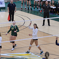 3rd year libero Taylor Ungar (13) of the Regina Cougars  and 3rd year outside hitter Ashlee Sanford (1) of the Regina Cougars in action during the Women's Volleyball Home Game vs Trinity Western  on October 28 at the CKHS University of Regina. Credit Matt Johnson/Arthur Images