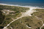 Nederland, Noord-Holland, Schoorl, 14-07-2008; nieuwe natuur: door een gegraven geul in de zeereep (duinen) stroomt bij hoog water het zeewater naar een duinvallei, hierdoor is een slufter ontstaan; boswachterij Schoorl; Noordzeestrand, strand, zand, duingebied. .luchtfoto (toeslag); aerial photo (additional fee required); .foto Siebe Swart / photo Siebe Swart
