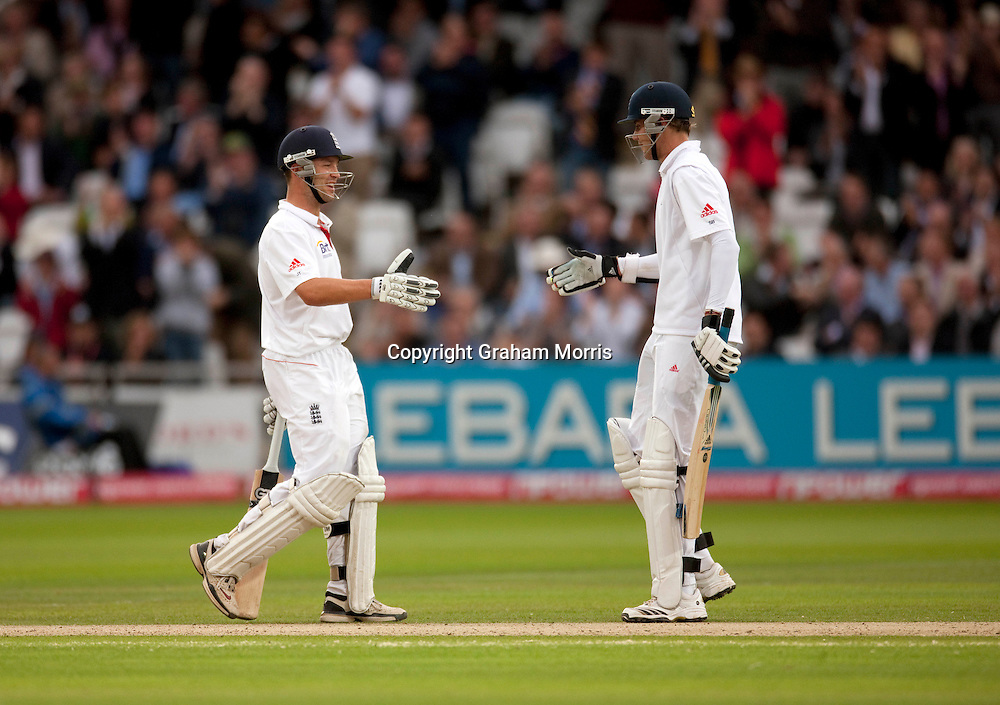 A double hundred partnership is celebrated by Stuart Broad and Jonathan Trott (left) during the final npower Test Match between England and Pakistan at Lord's.  Photo: Graham Morris (Tel: +44(0)20 8969 4192 Email: sales@cricketpix.com) 27/08/10