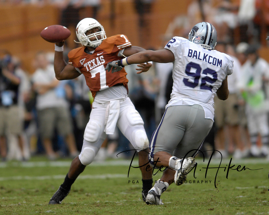 September 29, 2007 - Austin, TX..Quarterback John Chiles #7 of the Texas Longhorns throws down field against pressure from nose tackle Brandon Balkcom #92 of the Kansas State Wildcats in the fourth quarter, during a NCAA football game at Darrell Royal-Texas Memorial Stadium on September 29, 2007...FBC:  The Wildcats defeated the Longhorns 41-21.  .Photo by Peter G. Aiken/Cal Sport Media