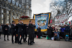 © London News Pictures. 27/03/2014. London, UK. The coffin of Tony Benn leaving Margaret's Church, Westminster, London after his funeral service. Former cabinet minister and veteran left-wing campaigner Tony Benn  died at home on March 14th following a long term illness. Photo credit : Ben Cawthra/LNP