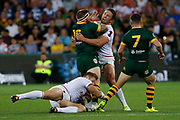 Joshua Mcguire of Australia gets tackled by Sam Burgess of England  during the Rugby League World Cup match between Australia and England at Melbourne Rectangular Stadium, Melbourne, Australia on 27 October 2017. Photo by Mark  Witte.