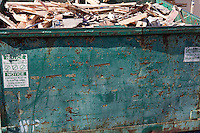 Overflowing dumpster with scrap wood