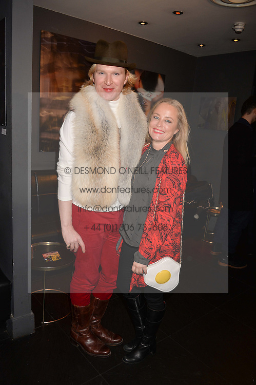 Henry Conway and Erica Bergsmeds at an exhibition of photographs by Erica Bergsmeds held at The Den, 100 Wardour Street, London England. 19 January 2017.