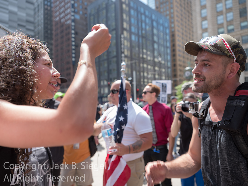 An anti-Trump protester and an anti-Sharia law protester appear to have a disagreement