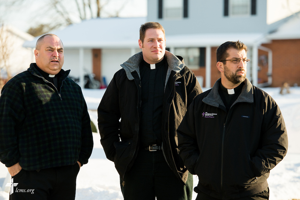 Rev. Thomas Heren (left) of Our Savior Lutheran Church in Washington, Ill., points out damage to neighborhoods with Rev. Michael W. Meyer, manager of LCMS Disaster Response (center), and Rev. Ross E. Johnson (right), director of LCMS Disaster Response, on Wednesday, Dec. 18, 2013.  Nearly two dozen tornadoes plowed through Illinois in November, killing a total of seven. The damaged LCMS church served as a relief center for members and nearby residents. LCMS Communications/Erik M. Lunsford