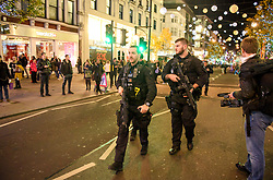 © Licensed to London News Pictures. 24/11/2017. London, UK. Armed police at The scene on Oxford Street after police responded to an incident. People have been advised to stay inside shops. Armed police are on the scene. Photo credit: Ben Cawthra/LNP