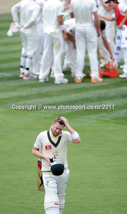 Michael Clarke heads back to the dressing room on Day 4 of the second cricket test between Australia and New Zealand Black Caps at Bellerive Oval in Hobart, Monday 12 December 2011. Photo: Andrew Cornaga/Photosport.co.nz