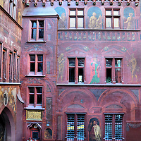 Rathaus Courtyard Paintings in Basel, Switzerland<br /> The inner courtyard of the Rathaus Town Hall in Basel, Switzerland, is a virtual art gallery of paintings with four predominate themes.  One displays law, legislation and justice, another are Biblical scenes, there are also important past citizens and political leaders and, finally, key moments in the city&rsquo;s history.  Several are from the 16th century by Hans Holbein and other Renaissance artists.