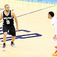 06 May 2016: San Antonio Spurs guard Tony Parker (9) looks to pass the ball past Oklahoma City Thunder guard Russell Westbrook (0) during the San Antonio Spurs 100-96 victory over the Oklahoma City Thunder, during Game Three of the Western Conference Semifinals of the NBA Playoffs at the Chesapeake Energy Arena, Oklahoma City, Oklahoma, USA.